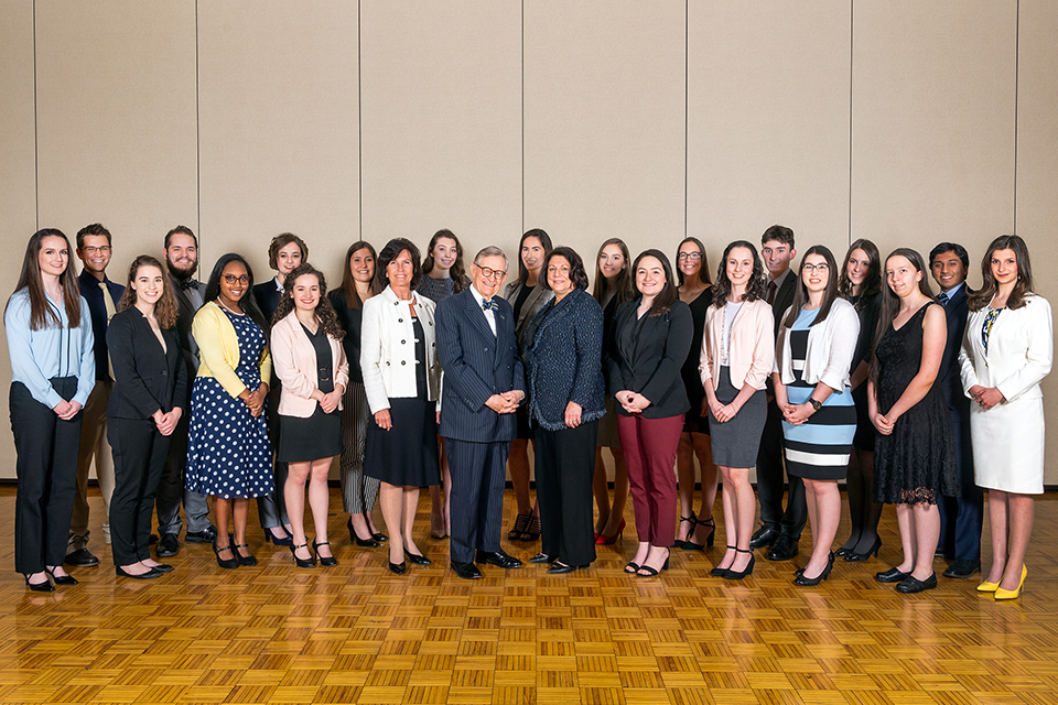 The 2019 WVU Bucklew Scholars meet with President Gordon Gee, center, who is flanked by Provost Joyce McConnell on his left and Cindi Roth, president of the WVU Foundation, on his right.