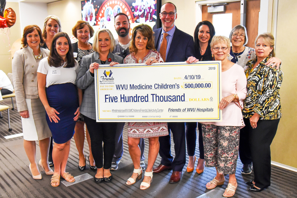 The Friends of WVU Hospitals Board of Directors presents a check for $500,000 to the WVU Medicine Children's 'Grow Children's' Capital Campaign.