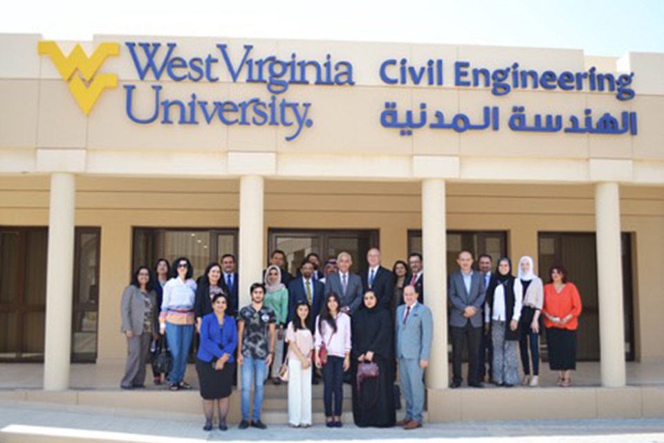 Supporters and students standing in front of the WVU-RUW Global Portal.