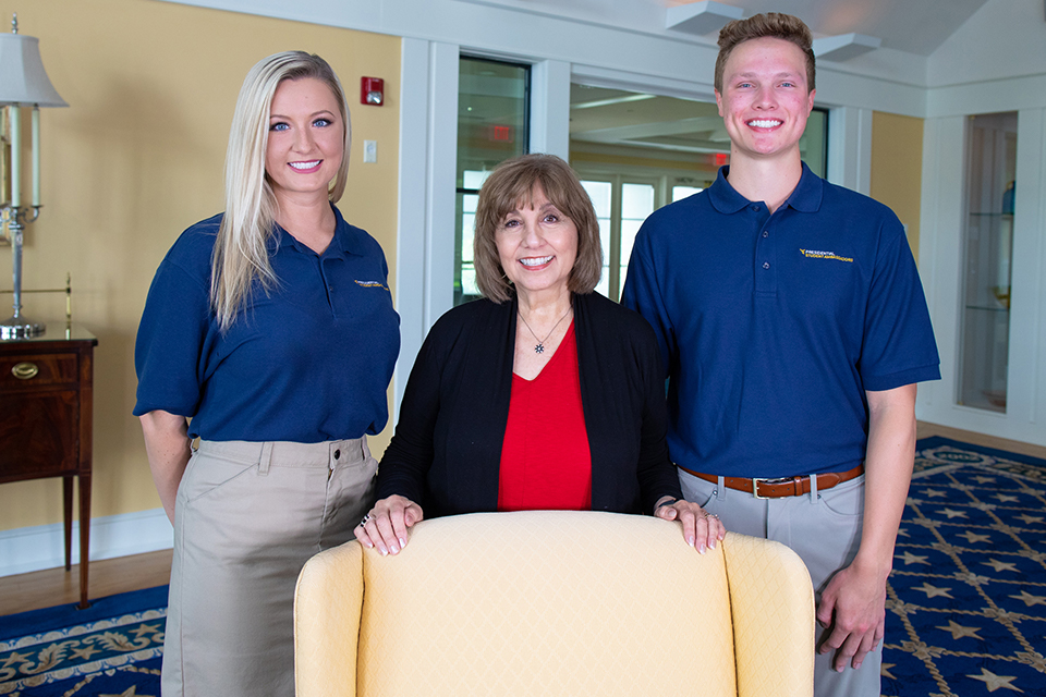 Carolyn Atkins, program coordinator, is flanked by Presidential Student Ambassadors Ashley Eby and Matthew Hudson.