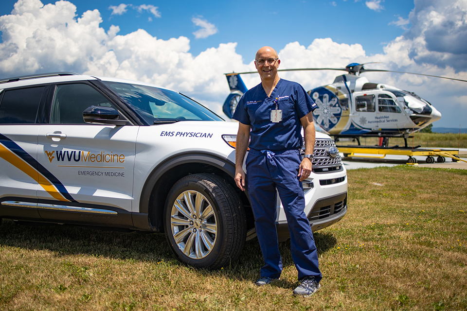 Dr. P.S. Martin, director of the WVU School of Medicine's Division of Prehospital Medicine and associate professor of emergency medicine, stands next to the specialized quick-response vehicle that will allow physicians to respond to emergencies.